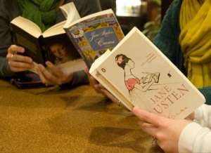 Hands holding copies of Emma